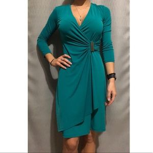 Teal/green professional dress. Very flattering fit